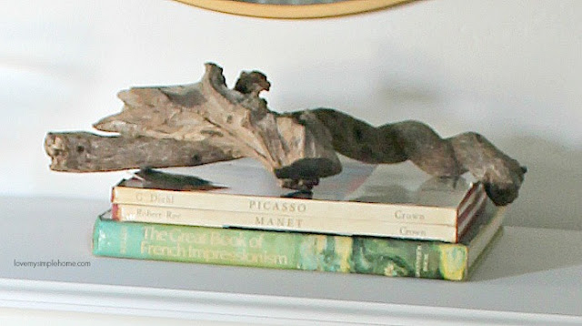 driftwood-stack-books-love-my-simple-home