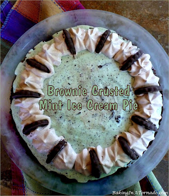 Brownie Crusted Mint Ice Cream Pie, mint chocolate mix-ins are folded into ice cream and frozen in a brownie crust. An assembly only summer treat. | recipe developed by www.BakingInATornado.com | #recipe #icecream