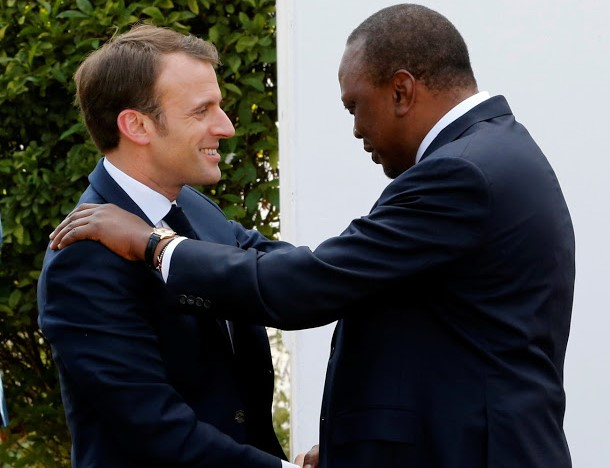 French President Emanuel Macron is welcomed by President Uhuru Kenyatta at State House on March 13, 2019.
