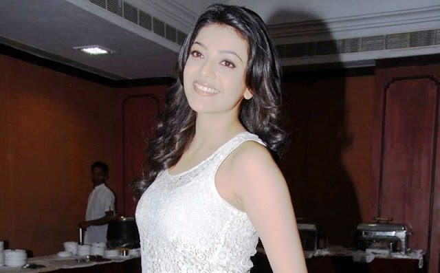 Kajal Agarwal Latest Cute Photos in White Top Tight Blue Jeans