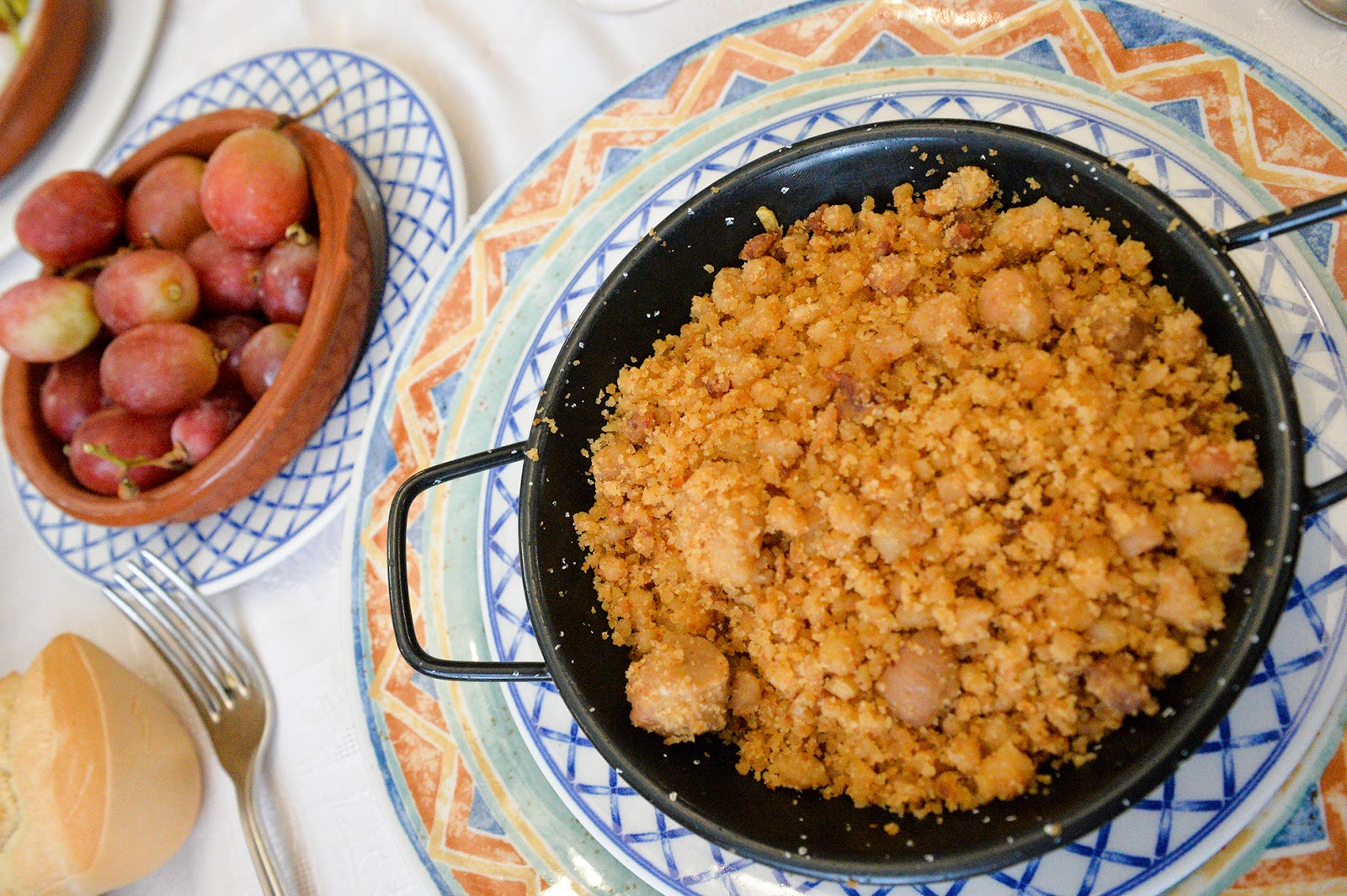 typical food comida tipica restaurante la mancha alcazar de san juan ciudad real spain migas uvas bread crumbs