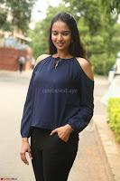 Poojita Super Cute Smile in Blue Top black Trousers at Darsakudu press meet ~ Celebrities Galleries 057.JPG