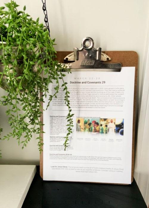 Come Follow me printable on shelf with plants