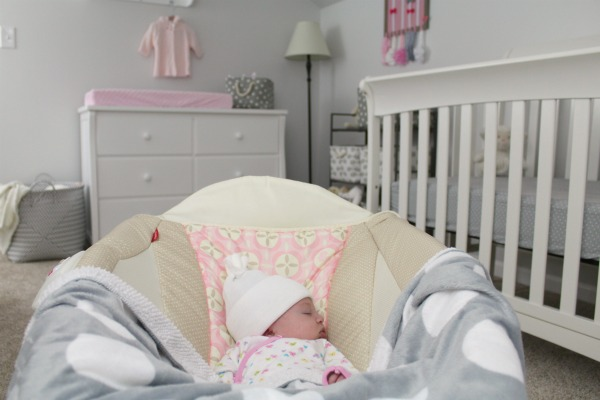 Gray white and light pink nursery for a baby girl