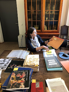 Marcia Lagerwey searches through documents related to Otto Dix's time at the Academy