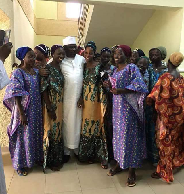 Senator Ali Ndume strikes a pose with 21 Chibok girls released by Boko Haram