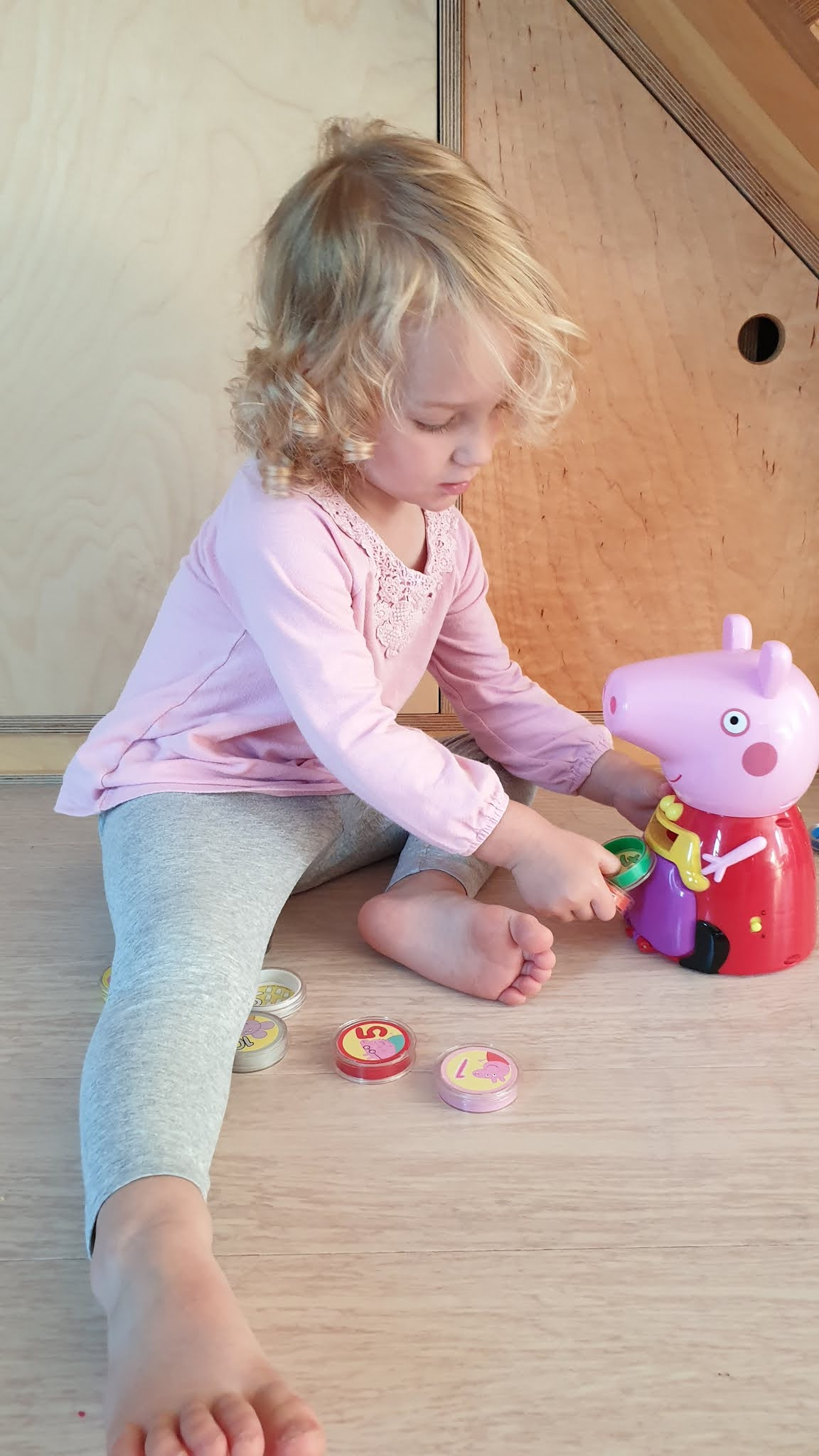 toddler playing with peppa pig counting toy