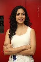 Actress Ritu Varma Stills in White Floral Short Dress at Kesava Movie Success Meet .COM 0073.JPG