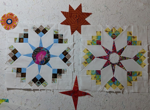 Two Shadow Star blocks on the design wall surrounded by three post choices: a flower medallion, a red four-pointed star, and a rust eight-pointed star.