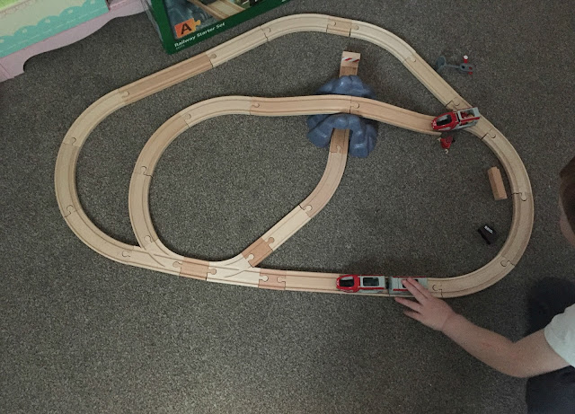wooden train track set up with a extension set to make bigger