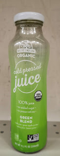 An open bottle of Nature's Nectar Green Blend Organic Cold Pressed Juice, from Aldi