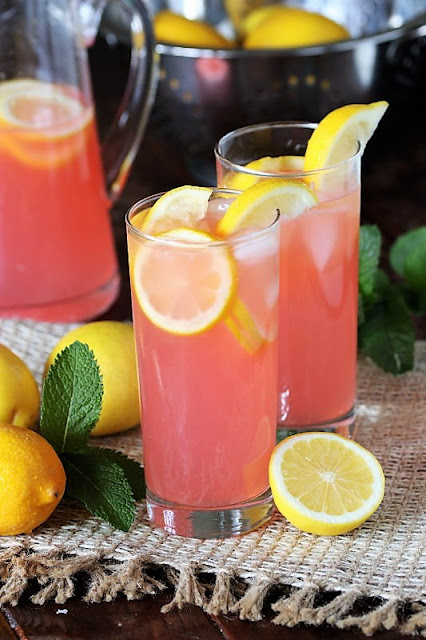 dinner Glass of Pink Lemonade With Lemon Slices Image