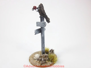 Vulture sitting atop sign post for 25-28mm scale miniature wargaming UniversalTerrain.com - left side view