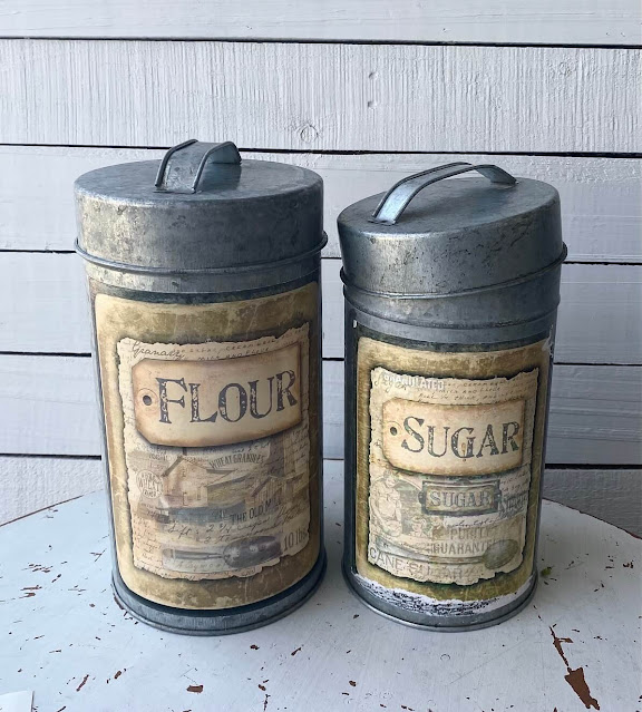 Photo of two galvanized canisters purchased at Goodwill.