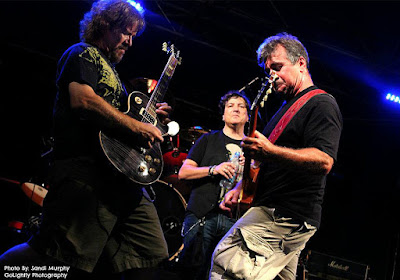 Dave Dipietro and Kenny Dubman jamming on stage together! With awesome lead throat Russell Arcara in the middle