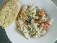 Pasta in white sauce with garlic bread