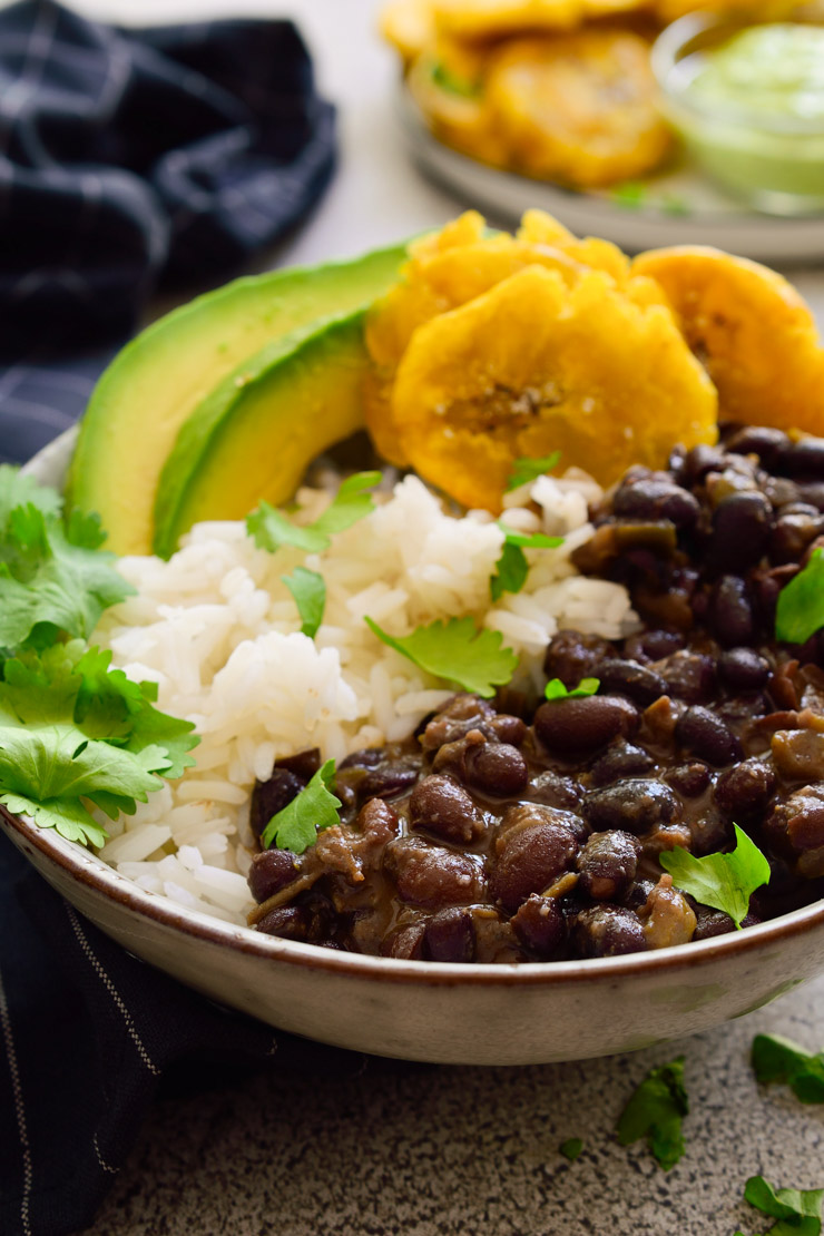 Cuban black beans and rice is a simple vegan recipe that's full of flavor and cheap to make. A hearty and delicious plant-based meal!