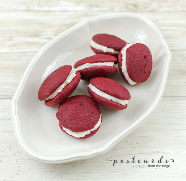red velvet whoopie pies on white oval dish