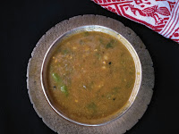 In Assamese style ground dry fish recipe : kosu aru hukoti, tender leaves and stems of colocasia leaves are cooked with hukoti and served as a side dish with steamed rice.