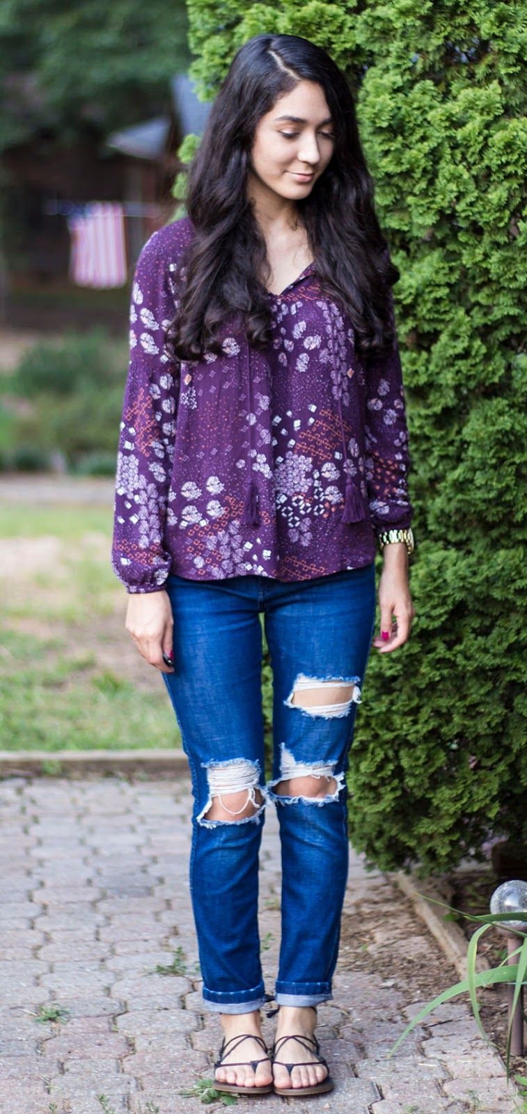 flowy print blouse and ripped jeans outfit