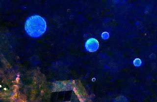 blue orbs in sky