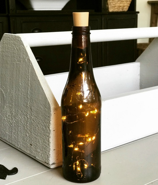 Use beer bottles to create a fairy light decoration for outdoors