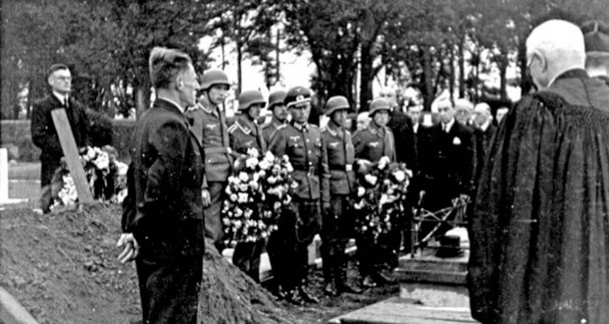 Hundreds of people lined the route but the Luftwaffe prevented them entering the gates of the cemetery.
