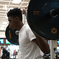Photo of Adonis lifting weights