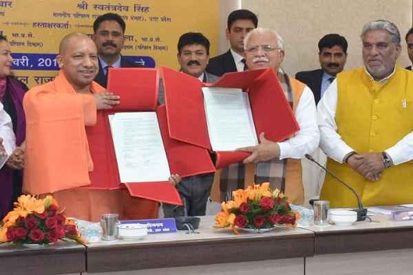 cm-yogi-cm-manohar-lal-khattar-signed-mou-reciprocal-transport-agreement