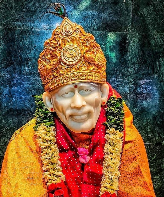 Orange Color Clothes wear Sai baba in this images