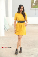 Actress Poojitha Stills in Yellow Short Dress at Darshakudu Movie Teaser Launch .COM 0008.JPG