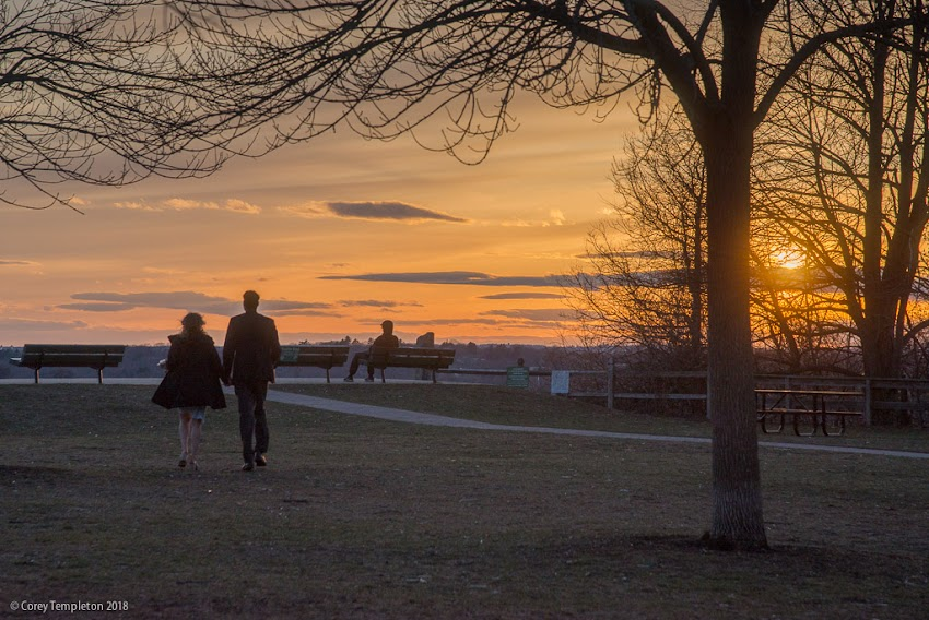 Portland, Maine USA April 2018 photo by Corey Templeton. Folks checking out the sunset from Fort Sumner Park, on North Street, a few evenings ago.
