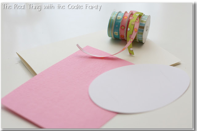 card, egg cut out, and ribbon