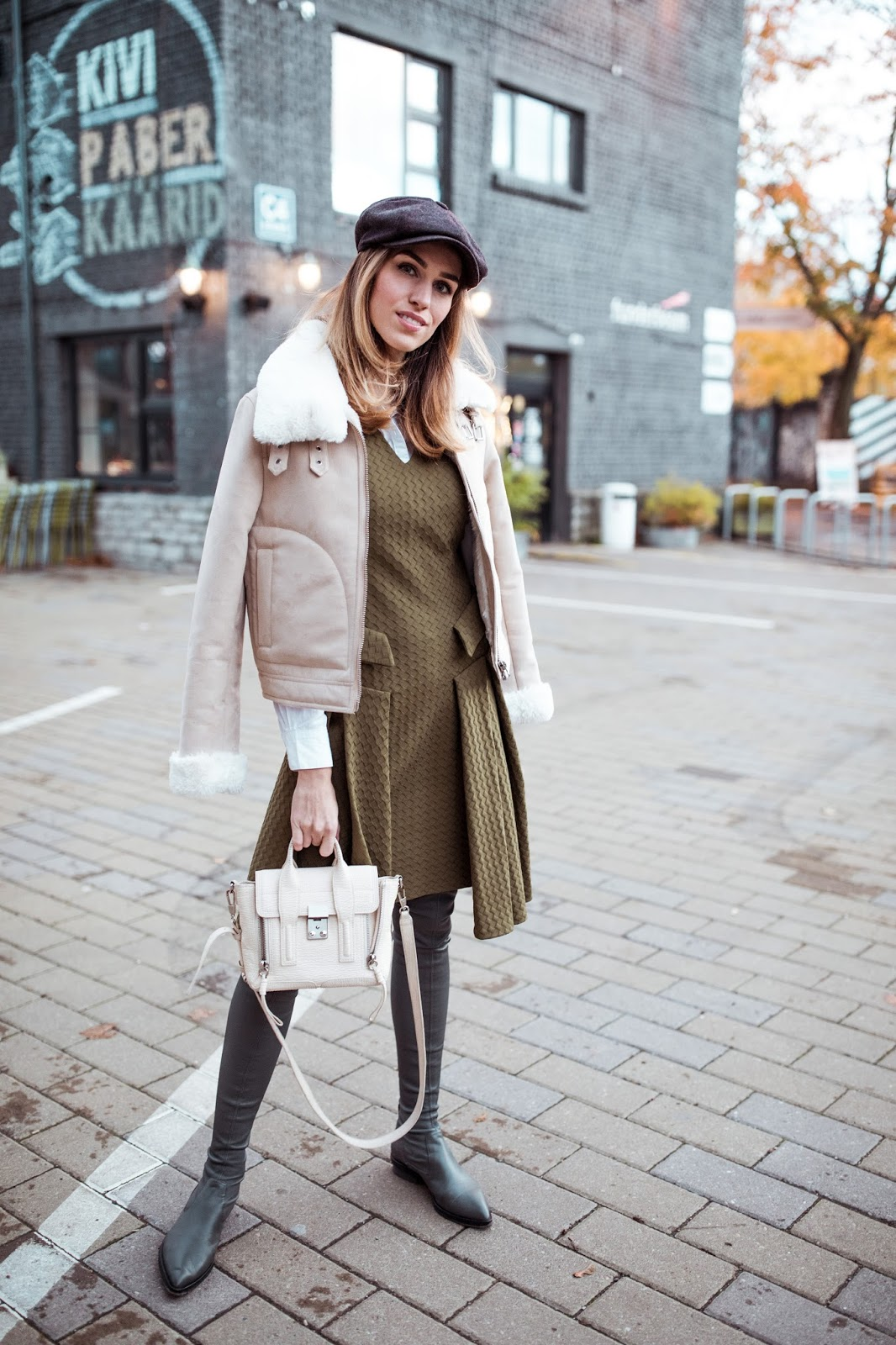 shearling jacket over knee boots fall outfit