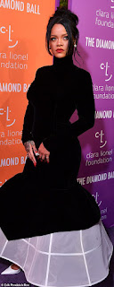 Rihanna parts crowds in dramatic black dress with hoop skirt