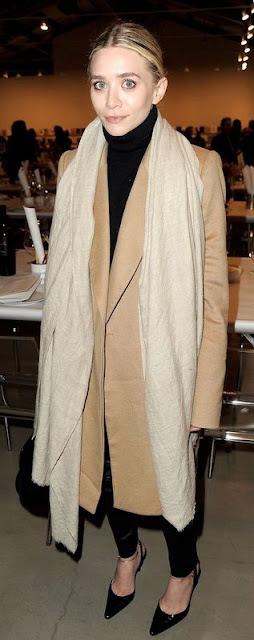 woman in camel trench coat