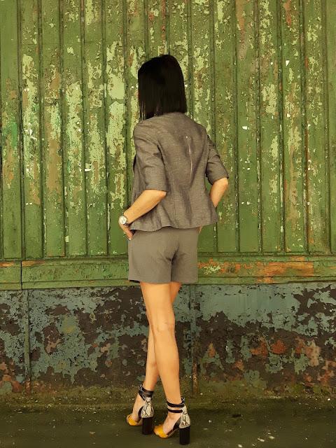 grey jacket grey shorts outfit