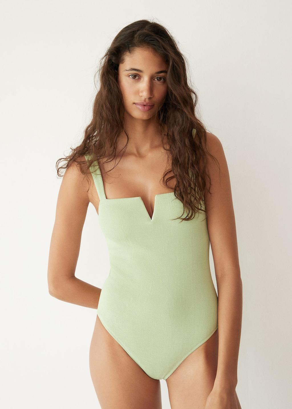 Under $100 swimsuit — stylish pastel green ribbed minimalist swimwear with cutout square neckline