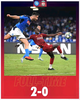 Dries Mertens' penalty and a late Fernando Llorente goal condemned Liverpool to defeat in their group E Champions League opener against Napoli.
