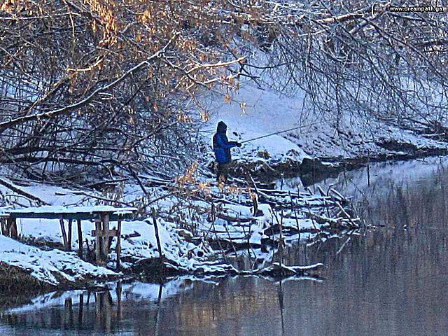 Fisherman near River