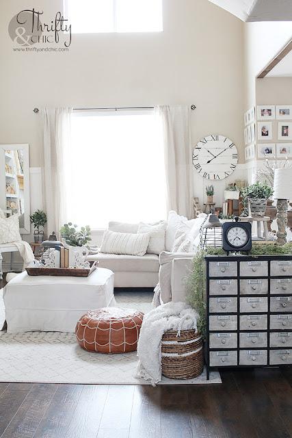 Farmhouse spring living room decor and decorating ideas. Living room inspo. Living room inspiration. White and wood living room. Spring mantel decor. spring mantle decorating ideas. Boho style living room.