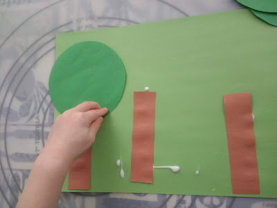Toddler Gluing the Treetops Onto Her Craft