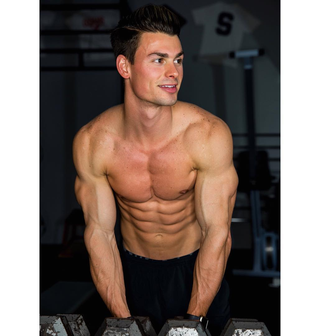 young-cute-muscular-guys-shirtless-body-abs-smiling-gym-lifting-weights