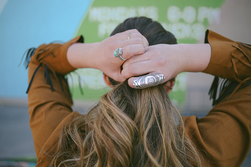 fringe suede jacket, big silver ring, turquoise ring