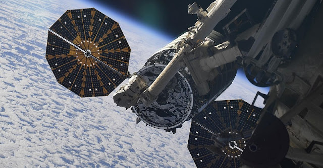 OA-9 Cygnus spacecraft docks with ISS. Credit: Oleg Artemyev
