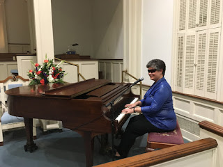 Laurel at the piano in the Village Chapel, The Village At Summerville, SC.