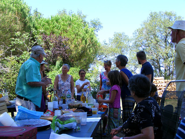 Lunch picnic party in a garden. Indre et Loire, France. Photographed by Susan Walter. Tour the Loire Valley with a classic car and a private guide.