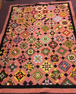 quilt top with a lot of different quilt blocks