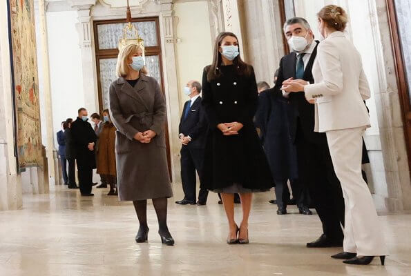 Queen Letizia wore a black double breasted pearl button wool blend coat from Carolina Herrera