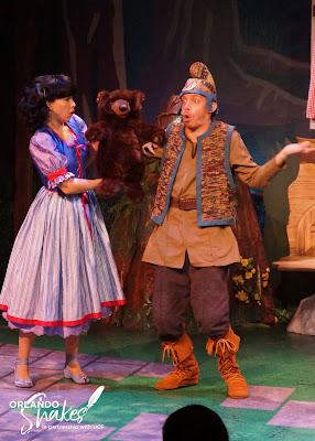 Snow White, Aja Grooms, holding a bear next to terrified Eric Fagan, the Hunstman.